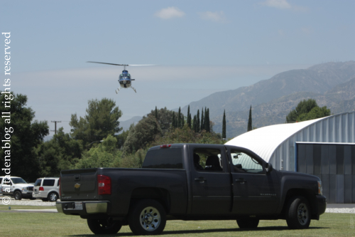 A Demonstration Of Police Strategy At The 2011 Heliport Open House While Bad Guys Are Holed Up In Truck Fly Dog To Drive Them Out